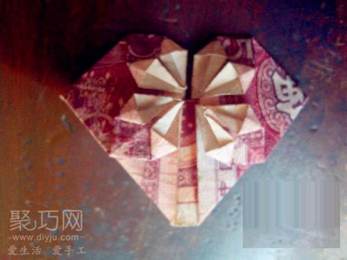 用5角钱叠心形的步骤图解 教你如何叠心